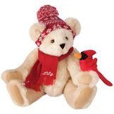 """15"""" Season's Greetings Bear - Front view of seated jointed bear dressed in a knit red and white nordic patterned hat with red scarf and holding a red cardinal. Bottom edge of scarf is personalized with """"Lily"""" in white lettering- Buttercream brown fur image number 1"""