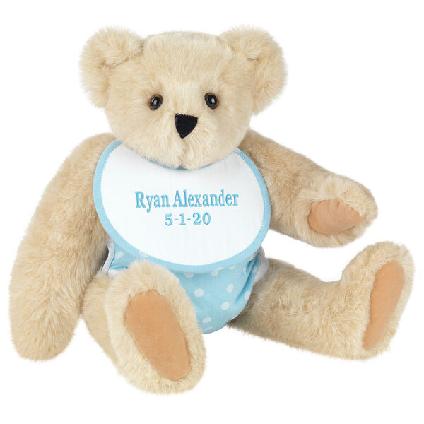 """15"""" Baby Boy Bear - Seated jointed bear dressed in light blue with white dots fabric diaper and bib. Bib with """"Ryan Alexander"""" and """"5-1-20"""" in light blue lettering - Buttercream brown fur image number 1"""