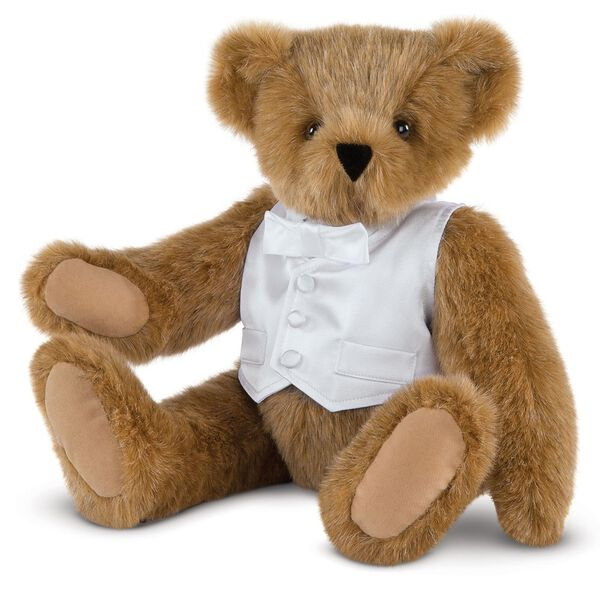 "15"" Special Occasion Boy Bear - Three quarter view of seated jointed bear dressed in a white satin vest and shirt front with bowtie - Honey brown fur image number 0"