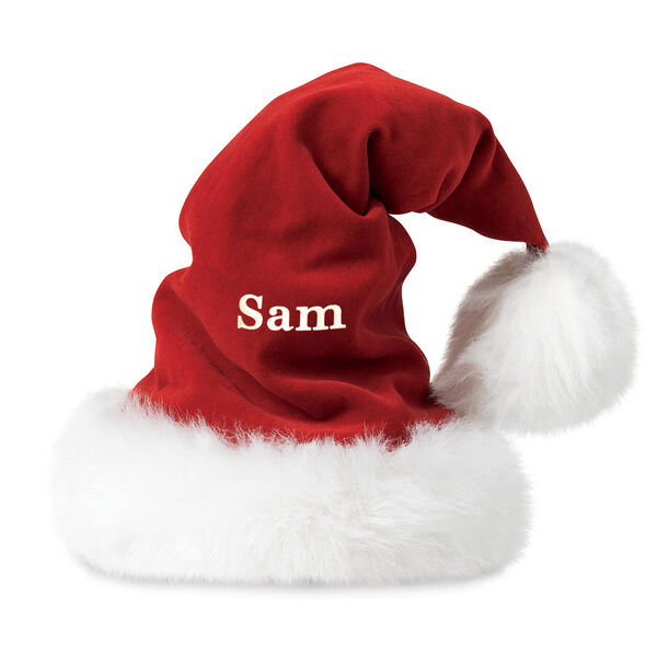 """Santa Hat - Front view of red velveteen hat with fur brim and personalized with """"Sam"""" image number 0"""