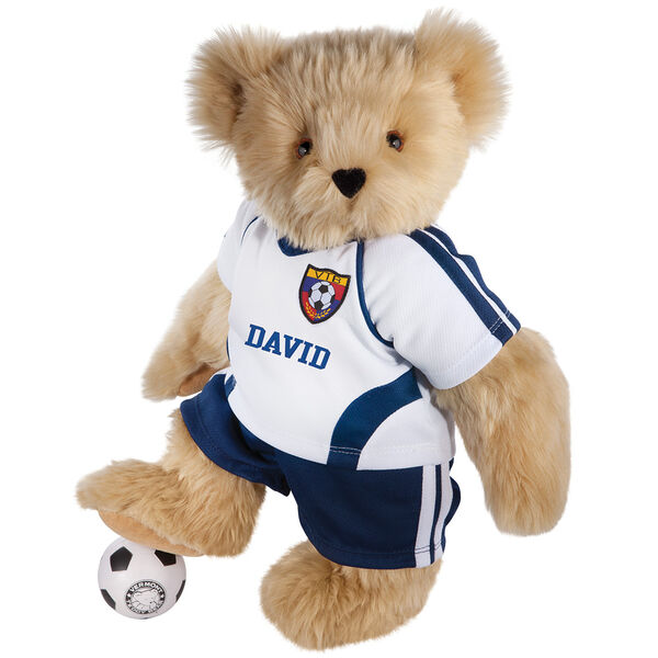 "15"" Soccer Bear - Three quarter view of standing jointed bear dressed in a blue and white jersey with VTB logo, blue shorts and comes with black and white soccer ball. Shirt is personalized with ""Emily"" on the front - Maple brown fur image number 4"