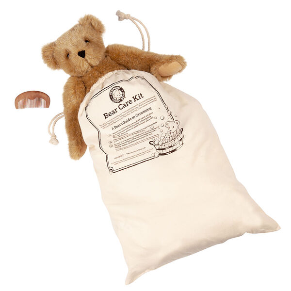 """15"""" Bear Care Bag with Comb - cream muslin bag with plush animal care instructions image number 0"""