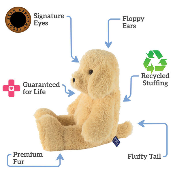 """18"""" Oh So Soft Puppy - Side view of seated tan 18"""" Puppy with tail and ivory foot pads text reads """"Signature Eyes; Floppy Ears; Guaranteed For Life; Fluffy Tail; Premium Fur; Recycled Stuffing"""".  image number 1"""