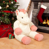 "4' Unicorn - Three quarter view of ivory 48"" unicorn with pink hooves, main, horn and tail in a Christmas scene image number 0"