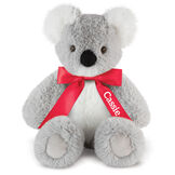 "18"" Oh So Soft Koala - Front view of seated 18"" gray koala with white muzzle, ears and belly wearing a red satin bow with tails personalized with ""Cassie"" in white lettering image number 1"