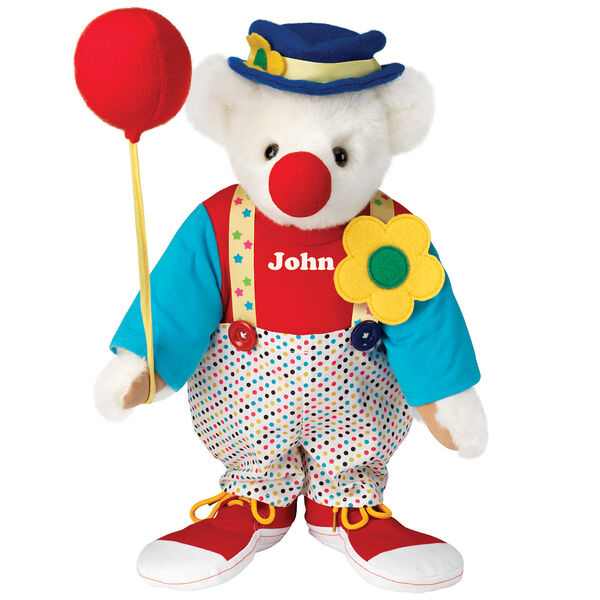 "15"" Clown Bear - Standing jointed bear dressed in dot pants with suspenders and daisy, red and blue shirt, blue hat, red clown shoes, and holds  red fabric balloon made personalized with ""John"" in white on shirt's center front - Vanilla white fur image number 2"
