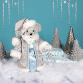 """15"""" Limited Edition Snowflake Santa - front view of gray standing bear in a silver and fur long coat with crystal snowflake in a winter scene image number 0"""