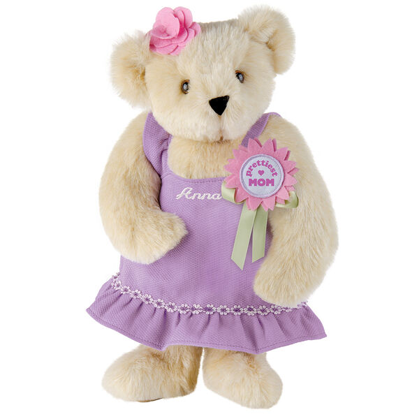 """15"""" Prettiest Mom Ever Bear - Front view of standing jointed bear dressed in a lilac sundress with felt flower pin that says """"Prettiest Mom"""" in pink and pink flower on ear; personalized with """"Anna"""" in cream on front of dress - Buttercream brown fur image number 1"""