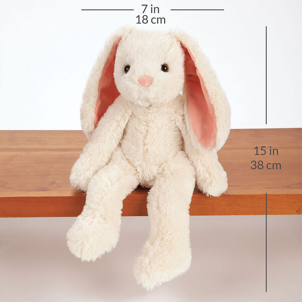 "15"" Buddy Bunny - Front View of ivory Bunny with pink ears and brown eyes sitting on a shelf  with a width measurement of 7 in or 18 cm and and length measurement of 15 in or 38 cm long.  image number 6"