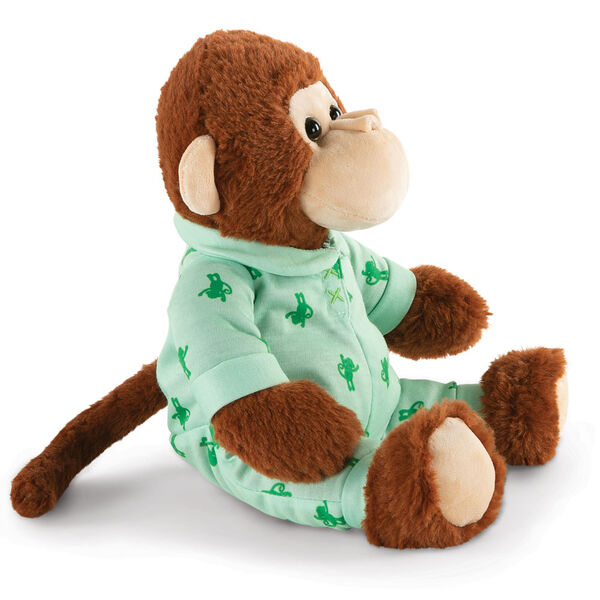 """13"""" PJ Pal Monkey - Three quarter view of seated cinnamon brown Monkey with tan muzzle in green cotton onesie pajamas with Monkey print  image number 2"""