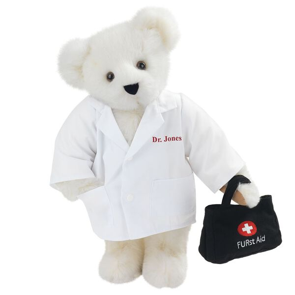 "15"" Doctor Bear - Front view of standing jointed bear dressed in white labcoat holding a doctor bag that is embroidered wth ""FURst Aid"" and a medical cross in red and white personalized with ""Dr. Jones"" on left chest in red - Vanilla white fur image number 2"