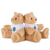 """13"""" Little Hero Bear - Buy 1, Give 1 - Three quarter view of 2 butterscotch light brown bears in white t-shirts with Little Hero Friend for Life Logos image number 2"""