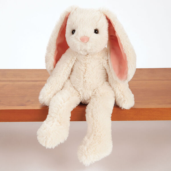 "15"" Buddy Bunny - Front View of ivory Bunny with pink ears and brown eyes sitting on a shelf image number 0"