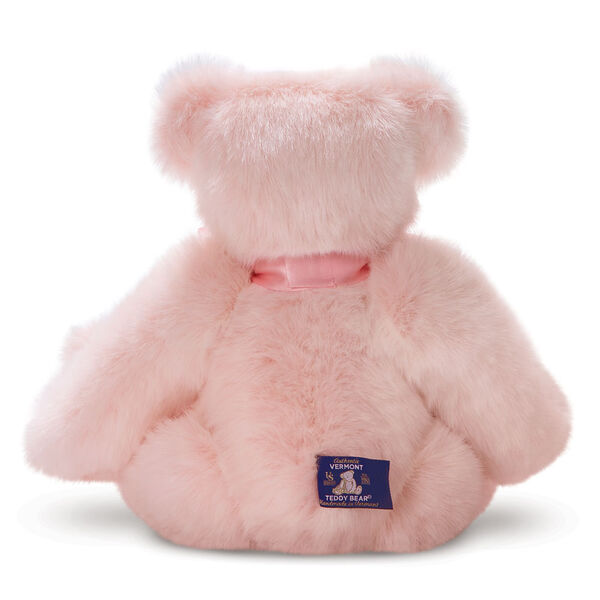 """15"""" Premium Baby Girl Bear - Back view of seated jointed pink bear wearing a pink satin bow. image number 3"""