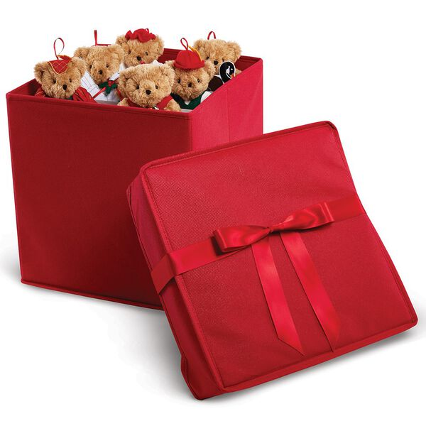 12 Days of Christmas Ornament Set - Red fabric box with satin ribbon has the cover off to the side and 6 light brown bears dressed in Christmas costumes are peeking out over the top.  image number 1