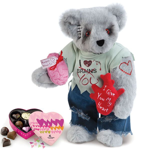 """15"""" Zombie Love Bear with Chocolates - Front view of standing jointed bear with blackened eyes and embroidered scar and red heart tattoo on right arm wearing torn t-shirt and jeans holding red heart, pink brain and 6 pc chocolates - gray fur image number 0"""