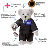 "15"" Joe Biden Bear - Standing Gray Bear with Blue eyes, black suit with text that says,""Guaranteed for Life; Signature Eyes; Biden/Harris Campaign Pin; Poseable Limbs; Signature Aviator Sunglasses; 100% Handmade in Vermont."" image number 1"