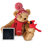 """15"""" Season's Greetings Bear - Front view of seated jointed bear dressed in a knit red and white nordic patterned hat with red scarf and holding a red cardinal. Bottom edge of scarf is personalized with """"Lily"""" in white lettering - Black image number 3"""