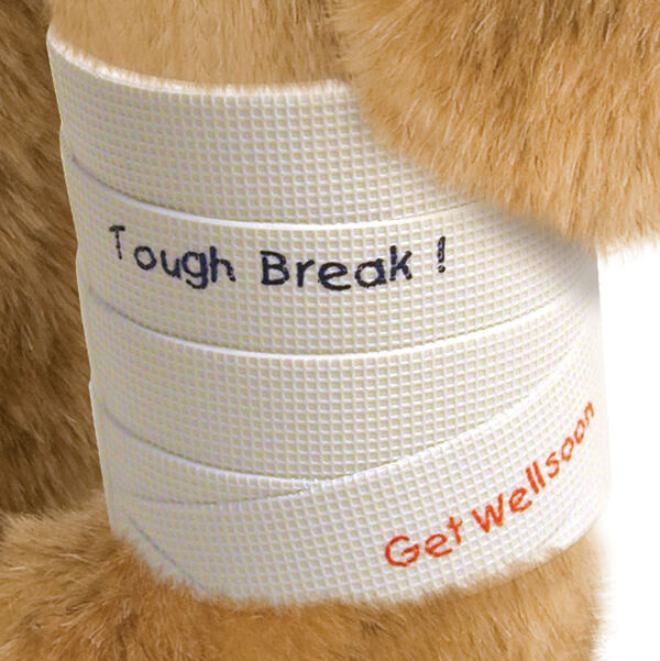 """15"""" Classic Bear Cast - white plastic cast on bear's left leg. Tough break' in black lettering and 'Get Well Soon' in red lettering are written on the cast.  image number 0"""