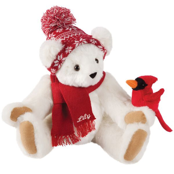 """15"""" Season's Greetings Bear - Front view of seated jointed bear dressed in a knit red and white nordic patterned hat with red scarf and holding a red cardinal. Bottom edge of scarf is personalized with """"Lily"""" in white lettering - Vanilla white fur image number 2"""
