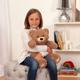 """8"""" Oh So Soft Teddy Bear - Front view of seated honey brown bear in a bedroom scene being held by a girl image number 6"""