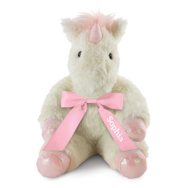 """18"""" Fluffy Fantasies Unicorn - Front view of seated creamy white Unicorn with iridescent pink horn and hooves and fluffy mane wearing pink satin bow  image number 2"""