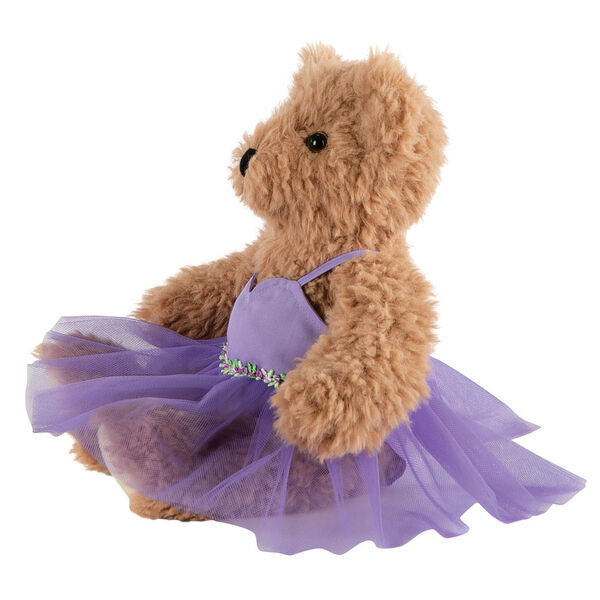 """13"""" Super Soft Ballerina Bear - Side view of seated Almond Brown Bear in purple ballerina dress with floral trim.  image number 2"""