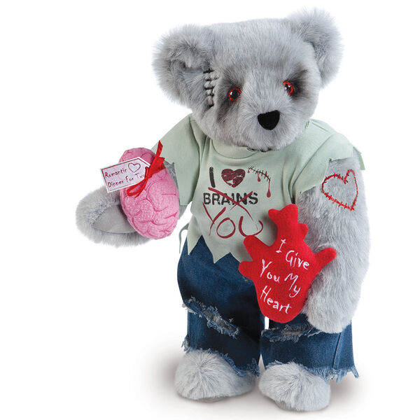 """15"""" Zombie Love Bear - Front view of standing jointed bear with blackened eyes and embroidered scar and red heart tattoo on right arm wearing torn t-shirt and jeans. Bear is holding red heart and pink brain - gray fur image number 0"""