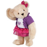 """15"""" Glitter Whimsy Bear - Three quarter view of standing jointed bear dressed in a pink skirt and hair bow, white shirt with butterfly graphic, purple shorts and sweater - Buttercream brown fur image number 1"""
