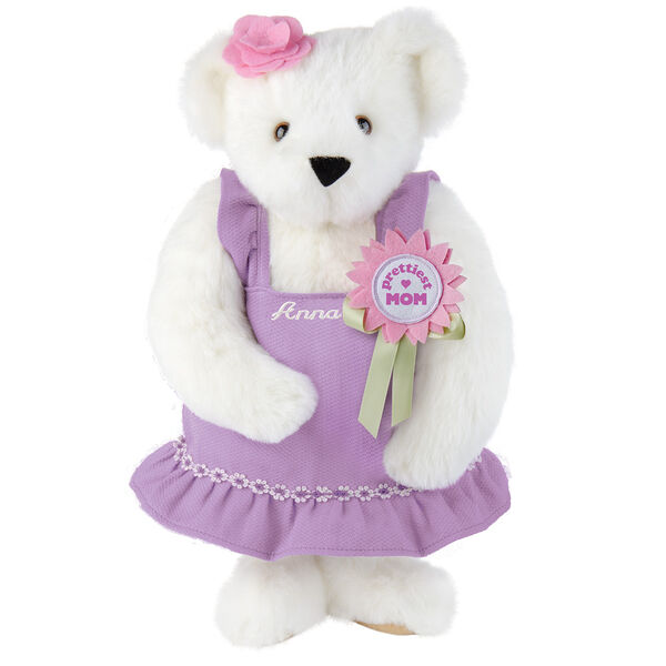 """15"""" Prettiest Mom Ever Bear - Front view of standing jointed bear dressed in a lilac sundress with felt flower pin that says """"Prettiest Mom"""" in pink and pink flower on ear; personalized with """"Anna"""" in cream on front of dress - Vanilla white fur image number 2"""