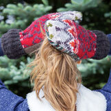 Bernie Mittens - Model wearing Adult One Size Assorted multi colored wool blend mittens with fleece lining image number 2