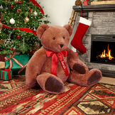 """4' Classic Big Bear - front seated view on cinnamon brown bear with dark brown foot pads in a Christmas scene with red satin bow personalized with """"Sarah"""" image number 0"""