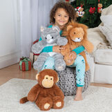 "18"" Oh So Soft Kitten - Front view of 18"" Kitten and 18"" Lion being hugged by a girl in pajamas sitting in a living room setting, 18"" Monkey is seated on the floor image number 2"