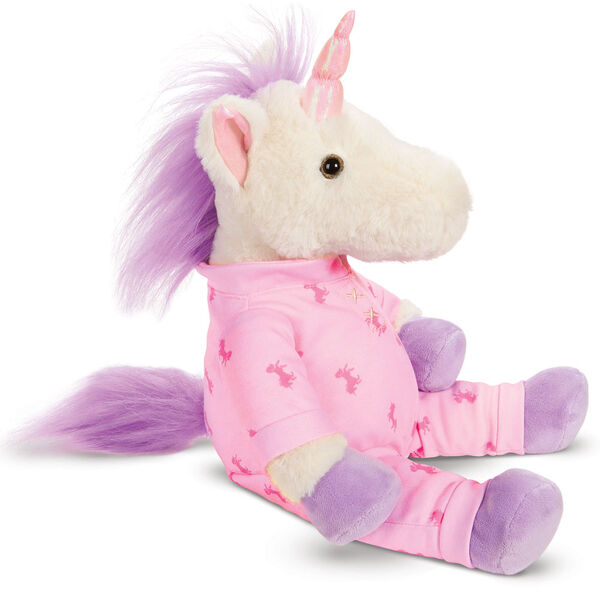 """13"""" PJ Pal Unicorn - Side view of cream unicorn with lavender hooves, horn, main and tail. Wearing pink unicorn print pajamas image number 2"""