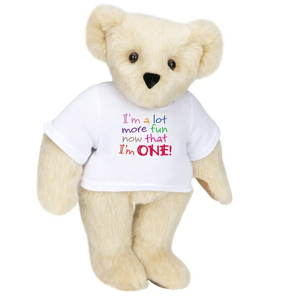"""15"""" Fun at One T-Shirt Bear - Front view of standing jointed bear dressed in white t-shirt with multi-colored graphic that says, """"I'm a lot more fun now that I am one!"""" - Buttercream brown fur image number 1"""