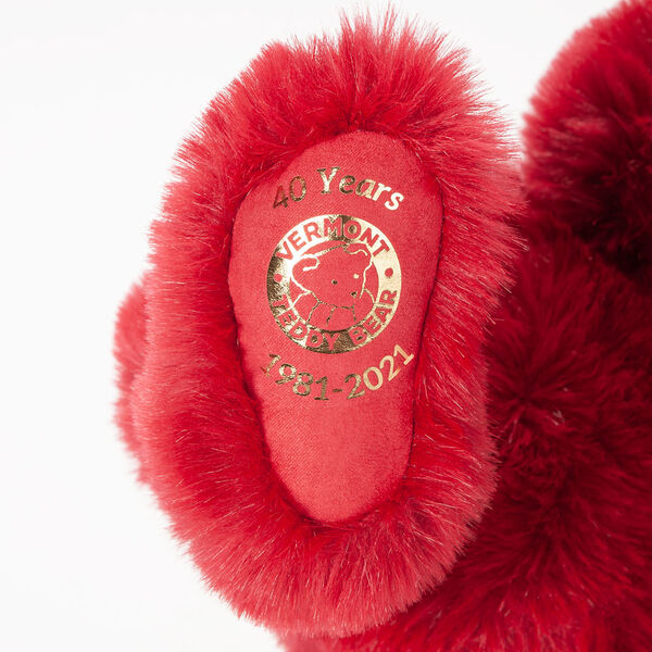 """20"""" Special Edition 40th Anniversary Bear - Close up of red foot pad with metallic gold Vermont Teddy Bear logo, """"40 Years"""" amd 1981-2021"""".  image number 1"""
