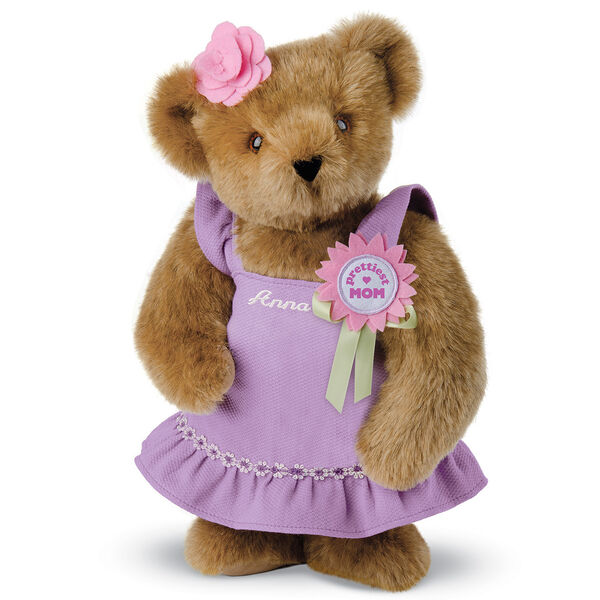 "15"" Prettiest Mom Ever Bear - Front view of standing jointed bear dressed in a lilac sundress with felt flower pin that says ""Prettiest Mom"" in pink and pink flower on ear; personalized with ""Anna"" in cream on front of dress - Honey brown fur"