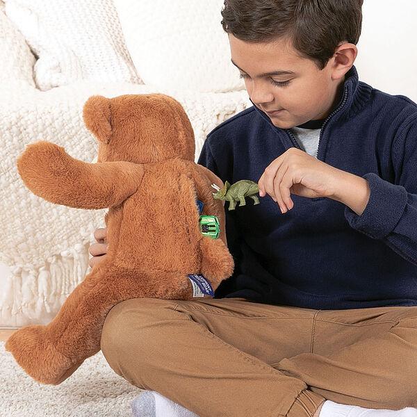 """18"""" Pocket Pal Bear - Back view of boy putting toys in back pocket of 18"""" ginger brown bear image number 3"""