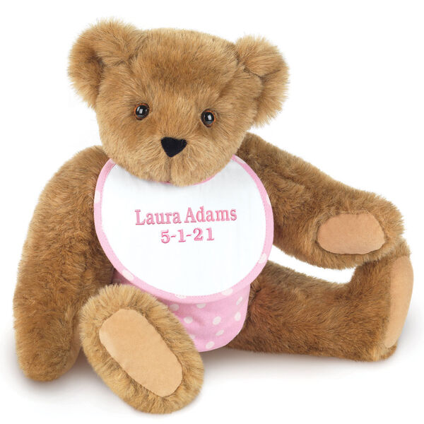 """15"""" Baby Girl Bear - Seated jointed bear dressed in pink with white dots fabric diaper and bib. Bib with """"Laura Adams"""" and """"5-1-21"""" in light pink lettering - Honey brown fur image number 0"""