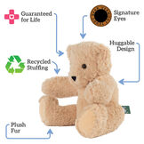 "15"" Spark Kindness Bear - Three quarter view of seated soft caramel brown bear, text around bear reads, ""Signature Eyes; Huggable Design; Plush Fur; Recycled Stuffing; Guaranteed For Life"".  image number 1"