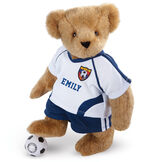 "15"" Soccer Bear - Three quarter view of standing jointed bear dressed in a blue and white jersey with VTB logo, blue shorts and comes with black and white soccer ball. Shirt is personalized with ""Emily"" on the front - Honey brown fur image number 0"