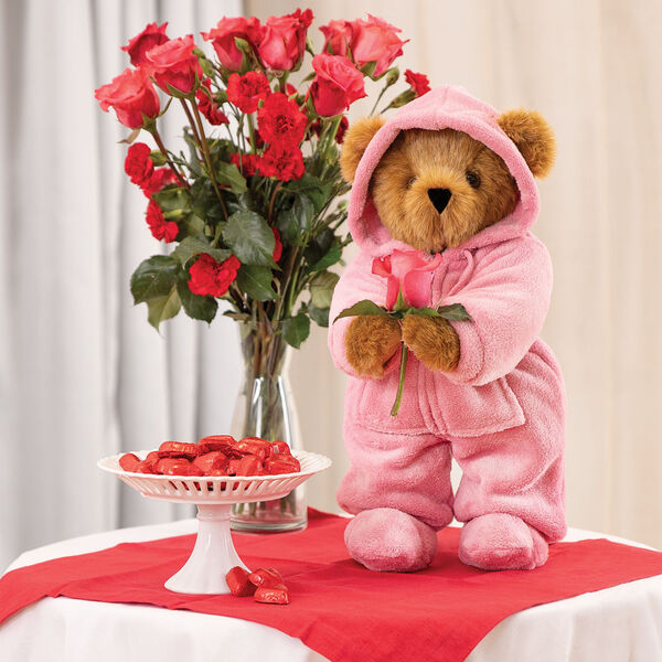 """15"""" Hoodie Footie Bear - Front view of standing jointed bear dressed in pink hoodie footie on a table with decorations image number 9"""