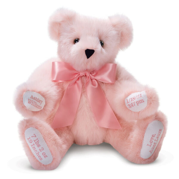 """15"""" Premium Baby Girl Bear - Front view of seated jointed pink bear with white paw pads and chose of eye color wearing a blue satin bow. All 4 paw pads are personalized with baby's name, birth date, pounds and inches at birth.  image number 1"""