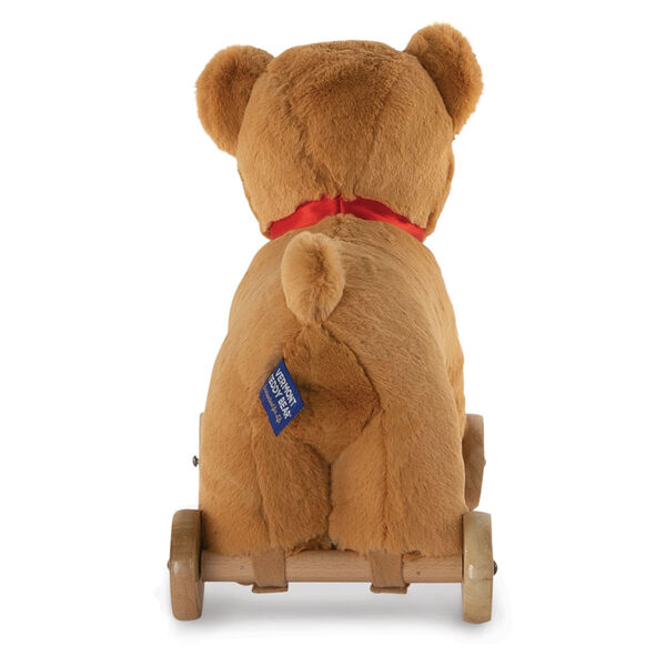 "12"" Rolling Bear Toy - Back view of golden bear with red satin ribbon on wooden detachable wheel frame image number 3"