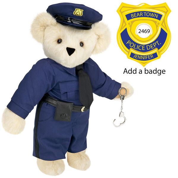 "15"" Police Officer Bear - Three quarter view of standing jointed bear dressed in a nacy blue police uniform with shirt, pants, black tie and hat and holding handcuffs. Personalize with a Police badge - Buttercream brown fur image number 1"