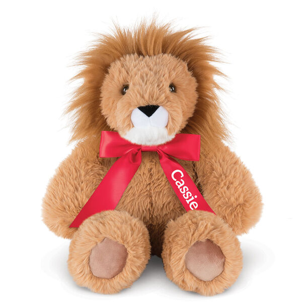 "18"" Oh So Soft Lion - Front view of seated 18"" brown lion with white muzzle and golden brown mane wearing a red satin bow with tails personalized with ""Cassie"" in white lettering image number 2"