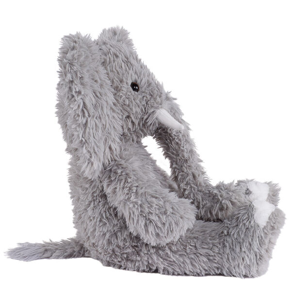 """18"""" Oh So Soft Elephant - Side view of seated gray Elephant with gray foot pads and white tusks and toe nails image number 3"""