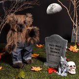 """15"""" Bearwolf - Front view of standing jointed long brown fur bear with red eyes wearing denim jeans in a graveyard scene image number 0"""