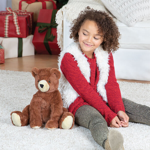 "18"" Softies Bear - Three quarter view of seated 18"" german chocolate bear sitting on the floor with a girl in a living room setting image number 0"