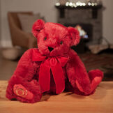 """20"""" Special Edition 40th Anniversary Bear - Seated jointed ruby red bear with red pads and gold Vermont Teddy Bear logo on right foot with red bow in a living room setting image number 3"""